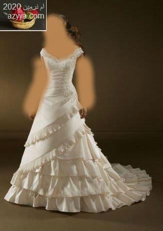 الدوحة الدولي السادس لمستلزمات الزفاف والأزياءفساتين زفاف قمة في البساطة